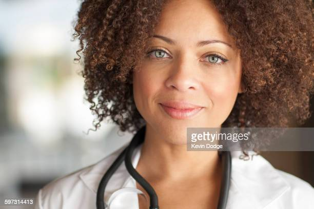 Close up of mixed race doctor smiling