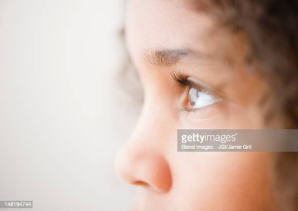 Close up of mixed race girl's face