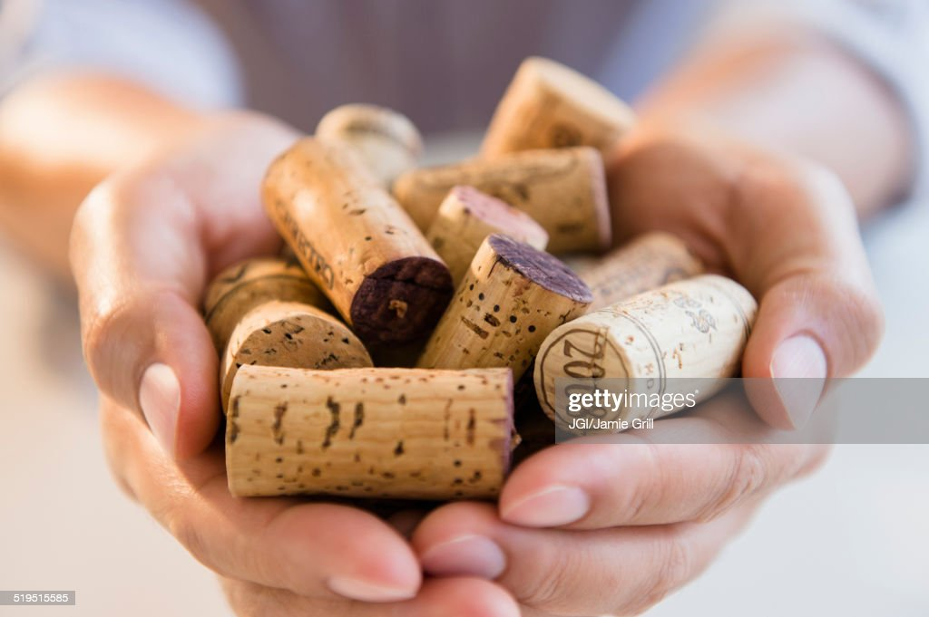 Close up of mixed race man holding wine corks