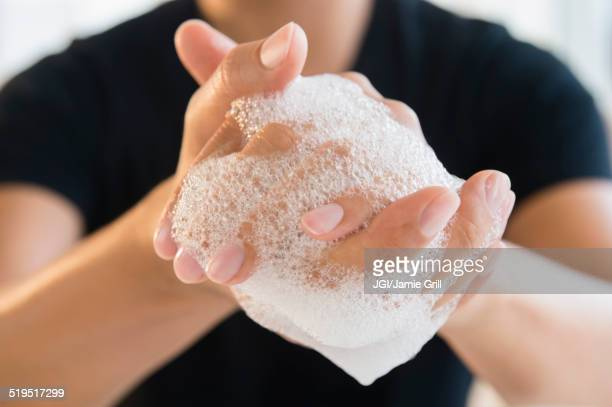 Close up of mixed race man washing his hands