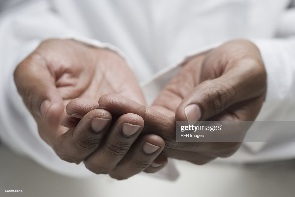 Close up of mixed race man's hands