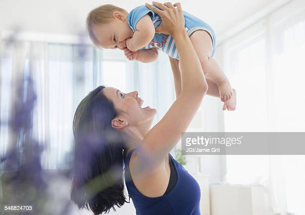 Close up of mixed race mother playing with baby