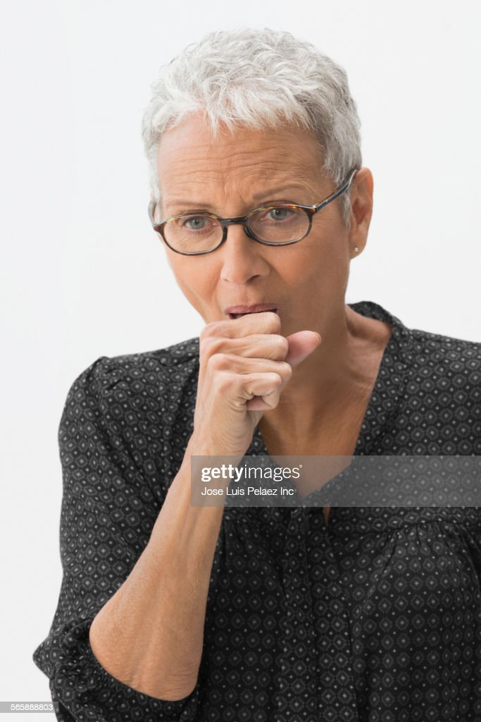 Close up of mixed race woman coughing