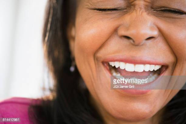 Close up of mixed race woman laughing