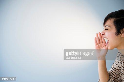 Close up of mixed race woman shouting