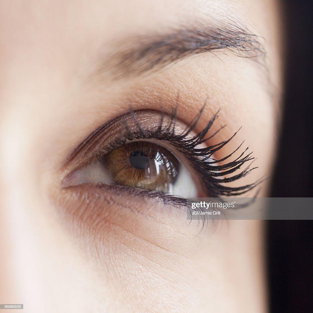 Close up of mixed race woman's eye : Stock Photo