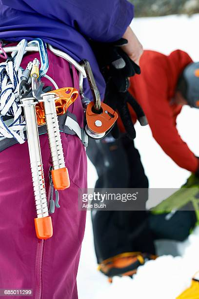 Close up of mountaineering equipment on mountaineers harness
