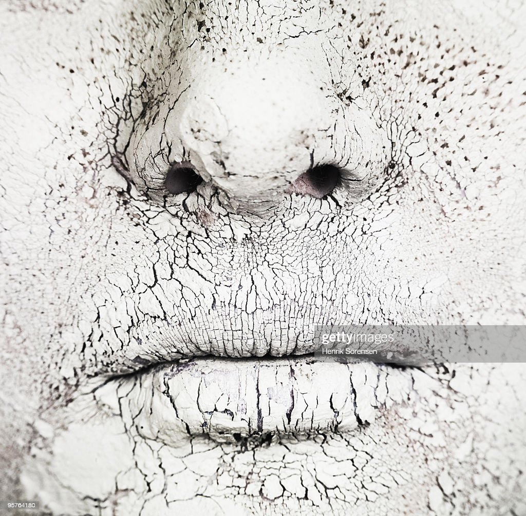 Close up of mouth and nose covered in dry mud : Stock Photo