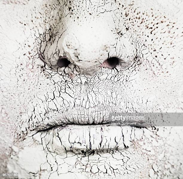 Close up of mouth and nose covered in dry mud