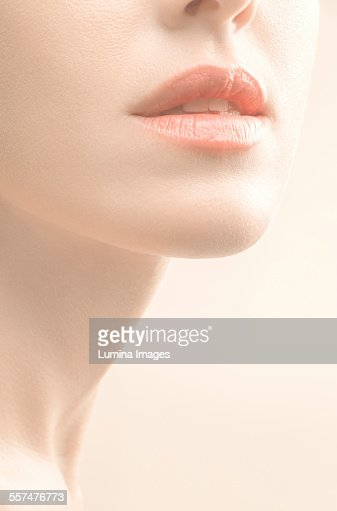 Close up of mouth, chin and neck of woman