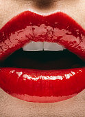 Close up of mouth of woman wearing red lipstick