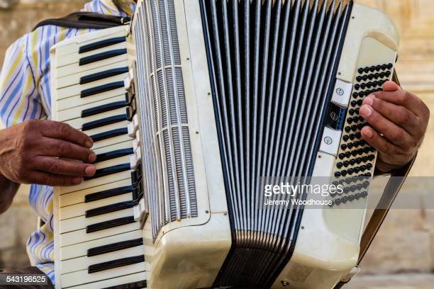 Close up of musician playing accordion