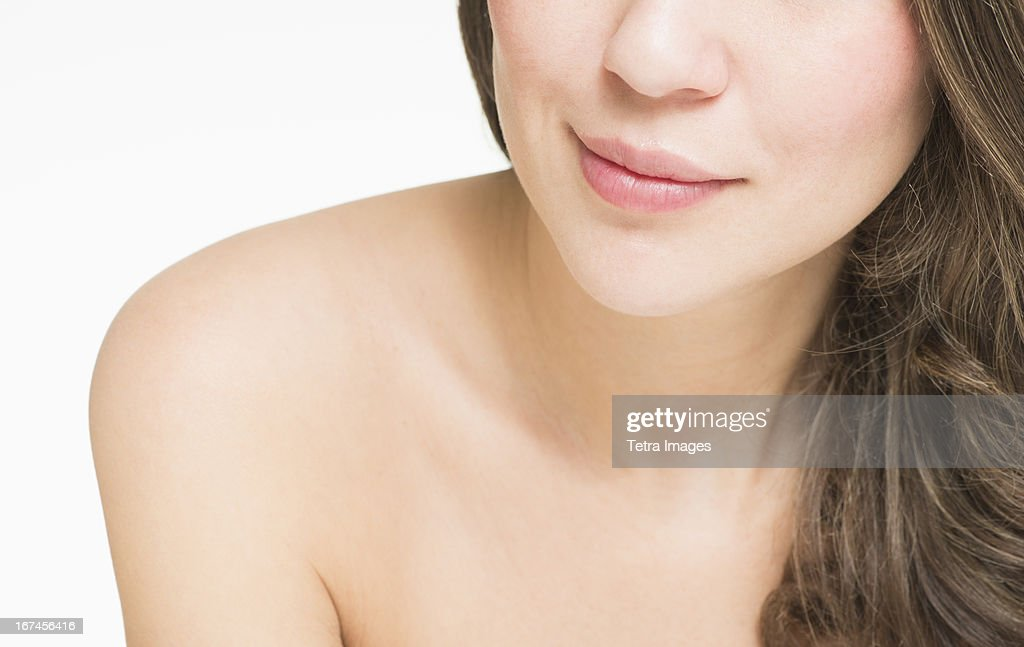 Close up of naked young woman, studio shot : Stock Photo