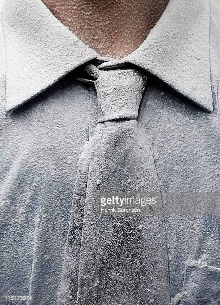 Close up of neck tie covered in dust