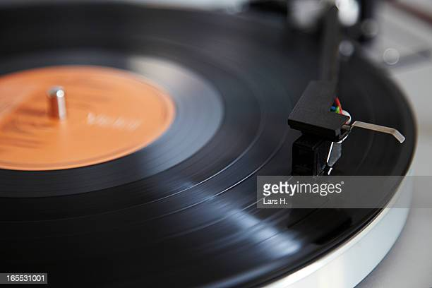 Close up of needle playing record