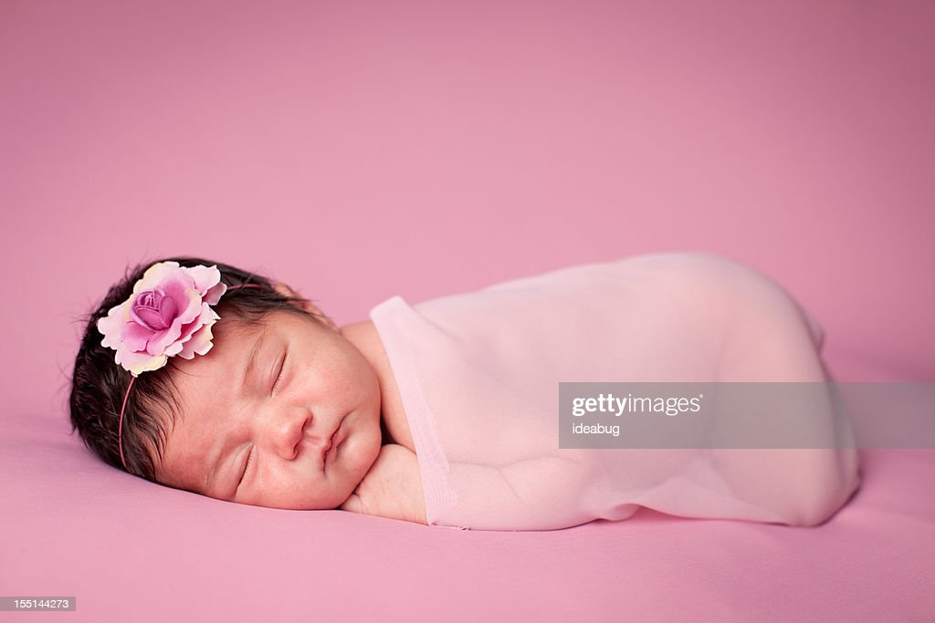 Close Up of Newborn Girl Wrapped in Sheer Fabric : Stock Photo