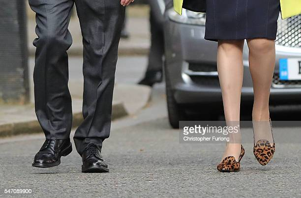 A close up of Newly appointed Prime Minister Theresa May and her husband Philip shoes as she arrives to speak with the press at 10 Downing Street on...