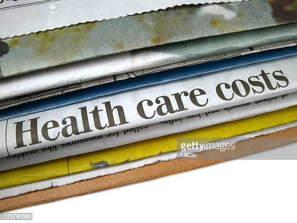 Close up of newspaper headline reading health care costs