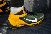 A close up of Nike cleats of the Green Bay Packers on the sideline during a game against the Tennessee Titans at LP Field on August 9 2014 in...