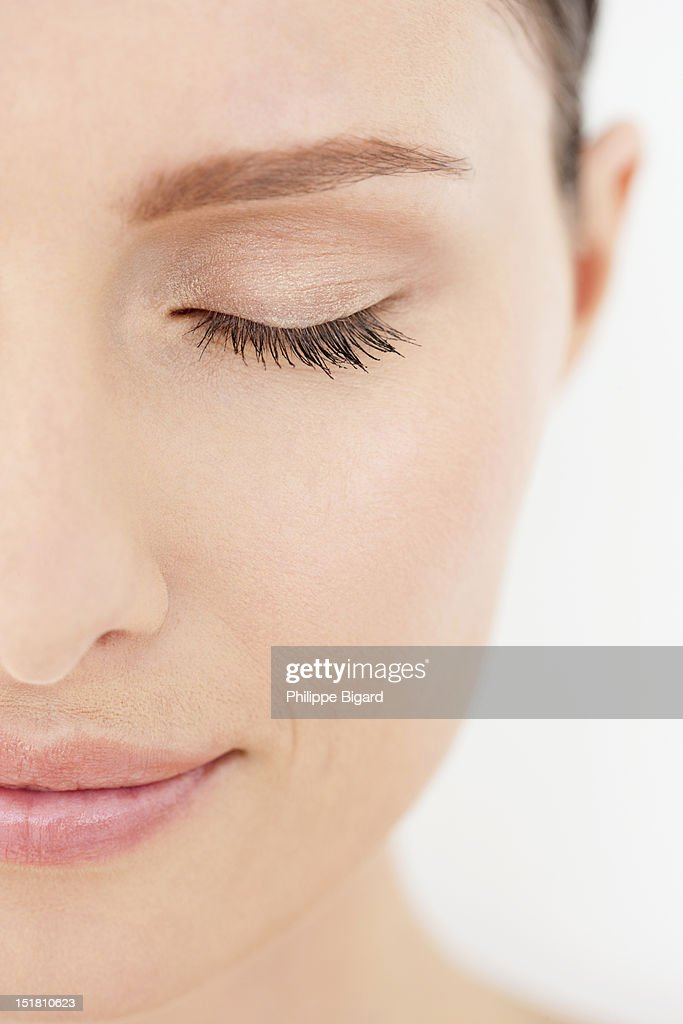 Close up of of calm woman with eyes closed : Stock Photo