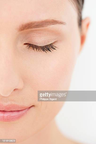 Close up of of calm woman with eyes closed