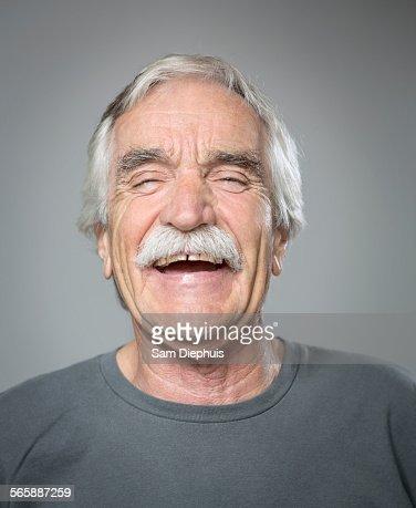 Close up of older Caucasian man laughing