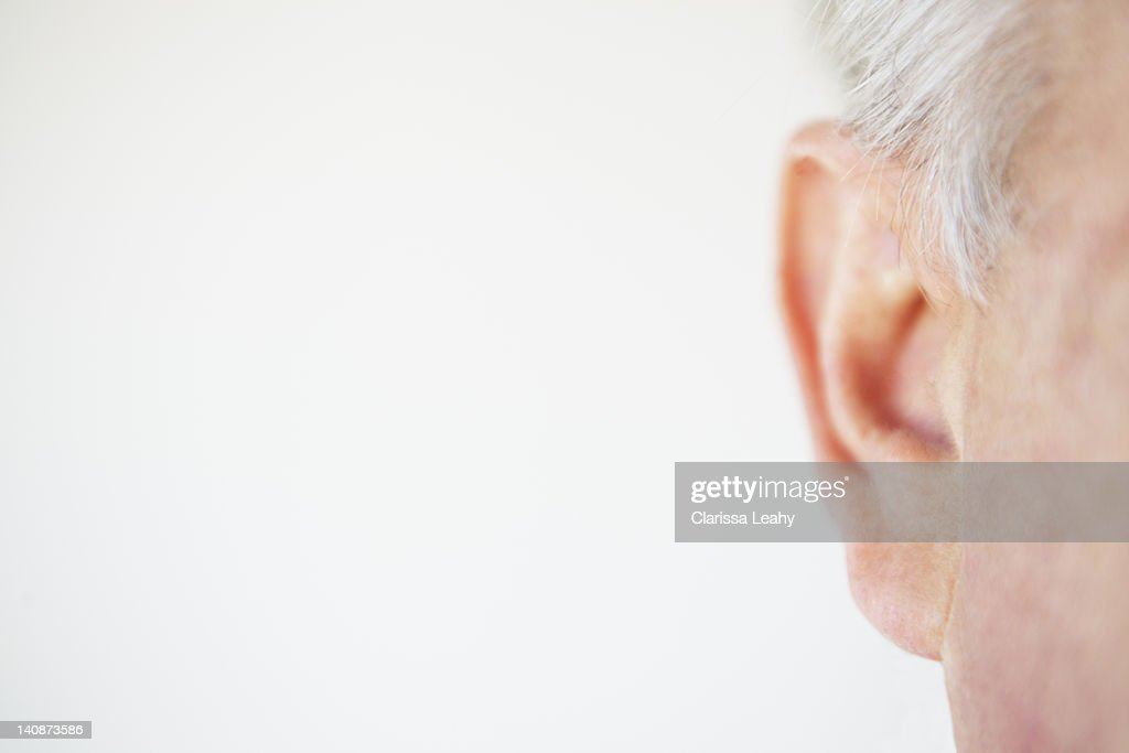 Close up of older persons ear