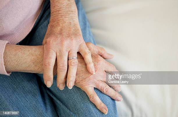 Close up of older womans folded hands