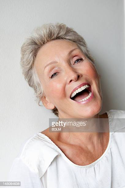 Close up of older womans smiling face