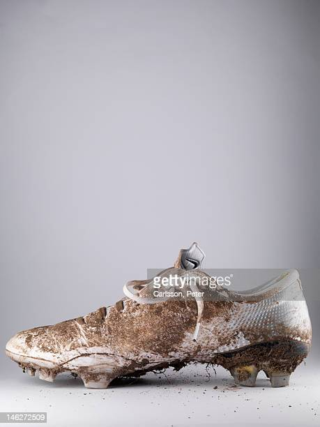 Close up of one  dirty soccer shoe