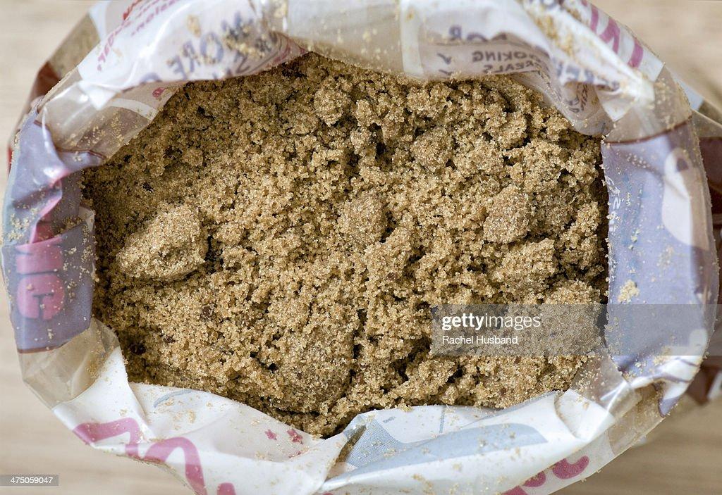 Close up of open bag of dark soft brown sugar