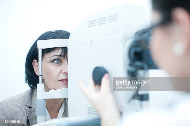 Close up of optician monitoring patient in eye clinic