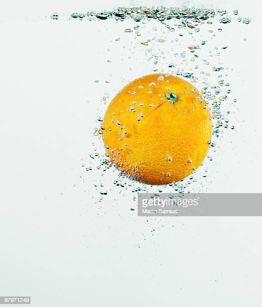 Close up of orange splashing in water