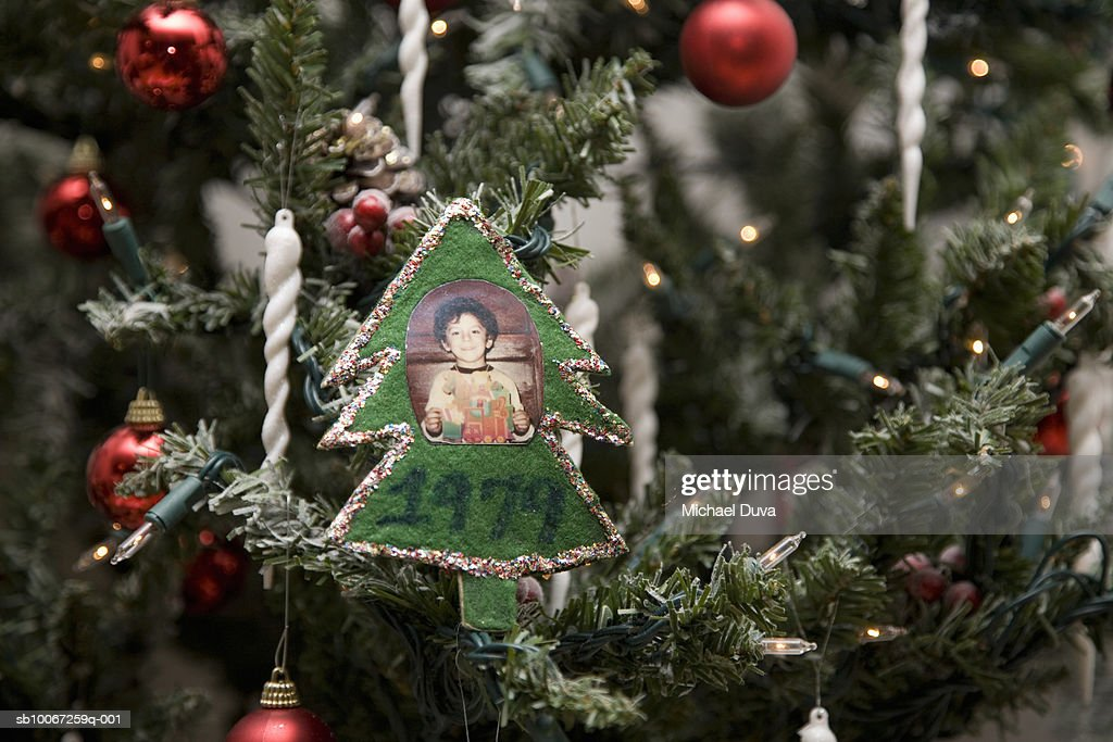 Close up of ornament with photograph and year '1979' on Christmas tree : Stock Photo
