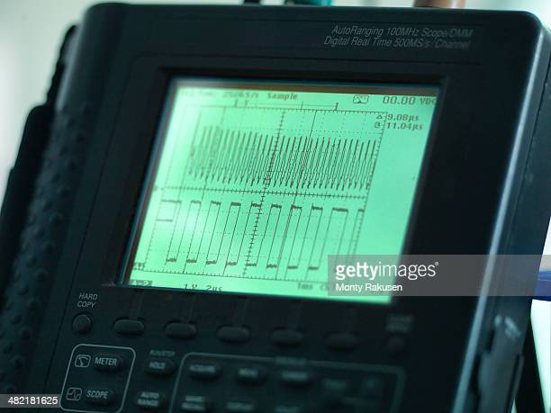 Close up of oscilloscope, used for testing circuit boards