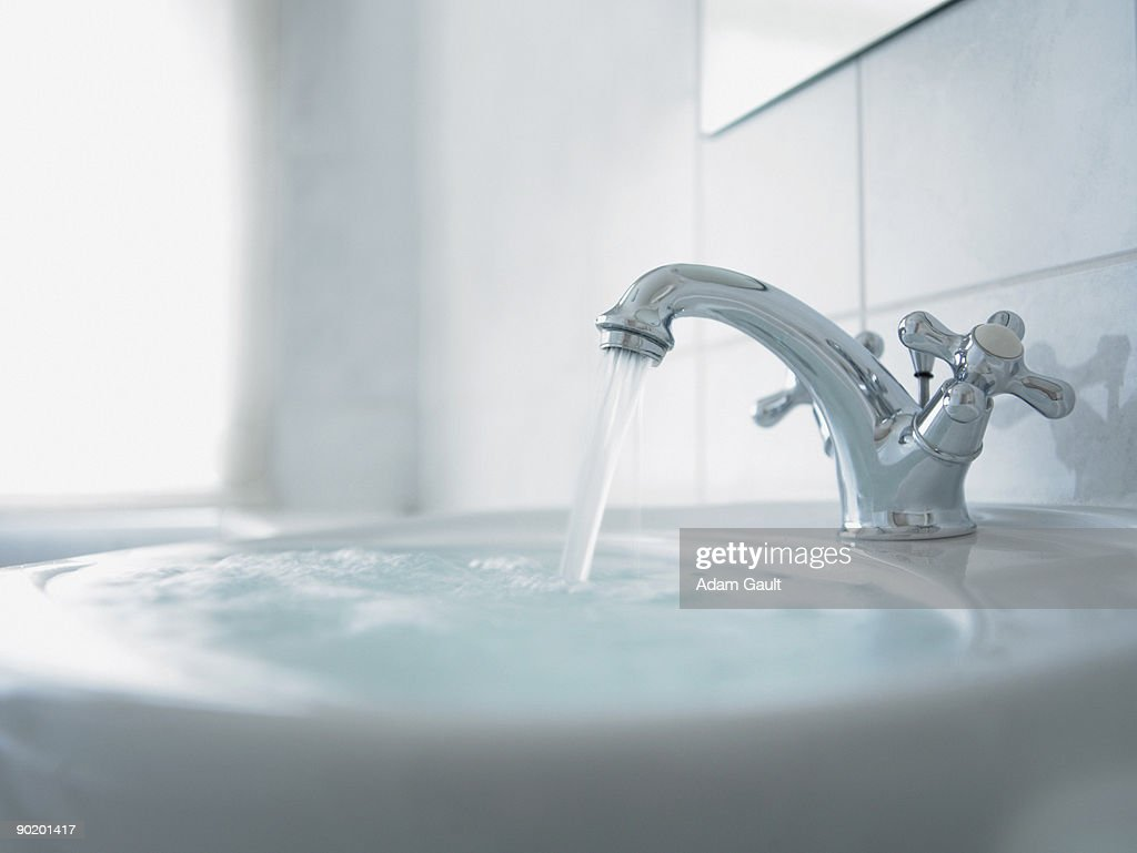 Close up of overflowing bathroom sink : Stock Photo
