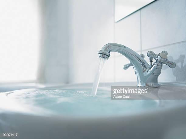 Close up of overflowing bathroom sink