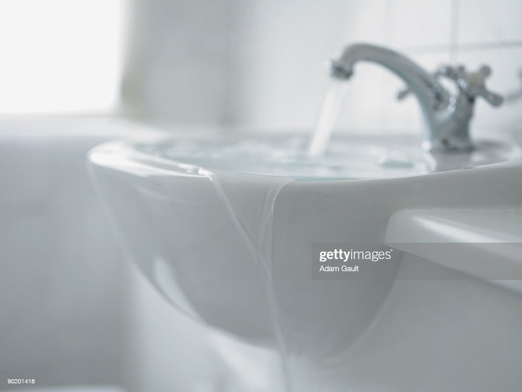 Close up of overflowing bathroom sink