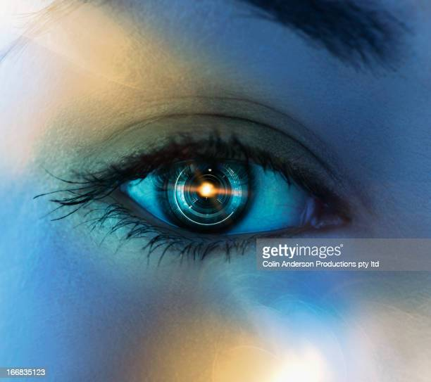 Close up of Pacific Islander woman's eye with mechanical lens