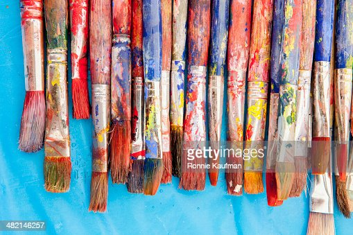 Close up of painter's messy brushes