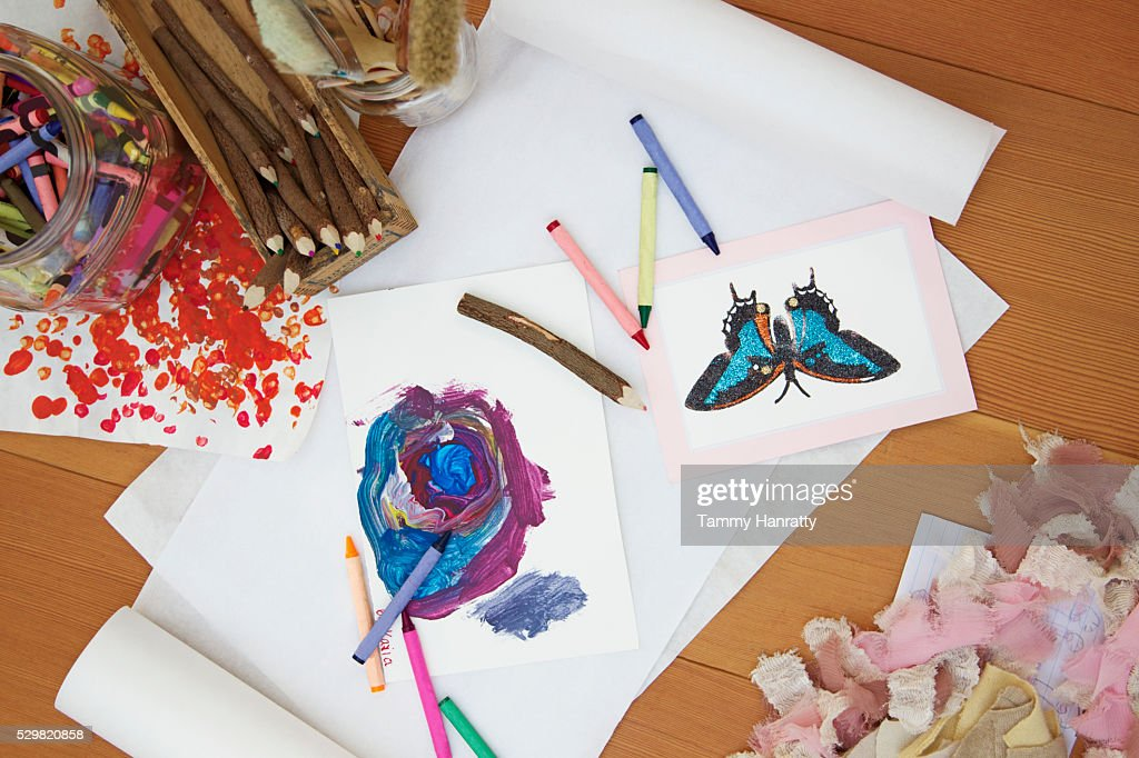 Close up of paintings and drawing tools on desk : Stock Photo