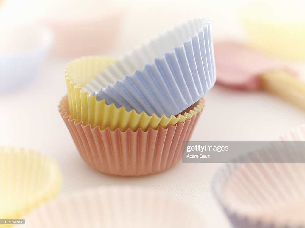 Close up of pastel cupcake holders : Stock Photo