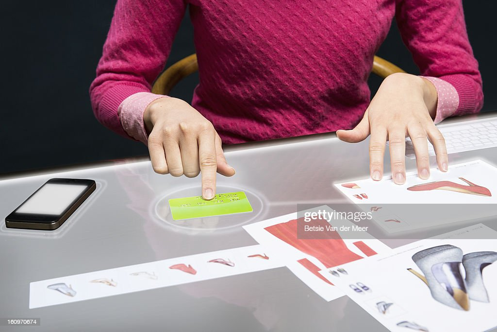 Close up of payment on interactive table. : Stock Photo