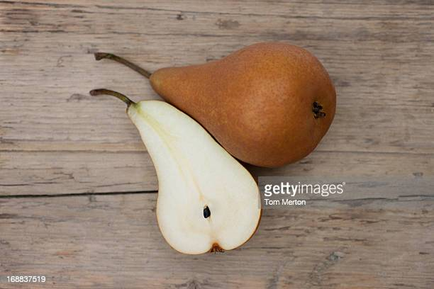 Close up of pear and pear slice on wooden board