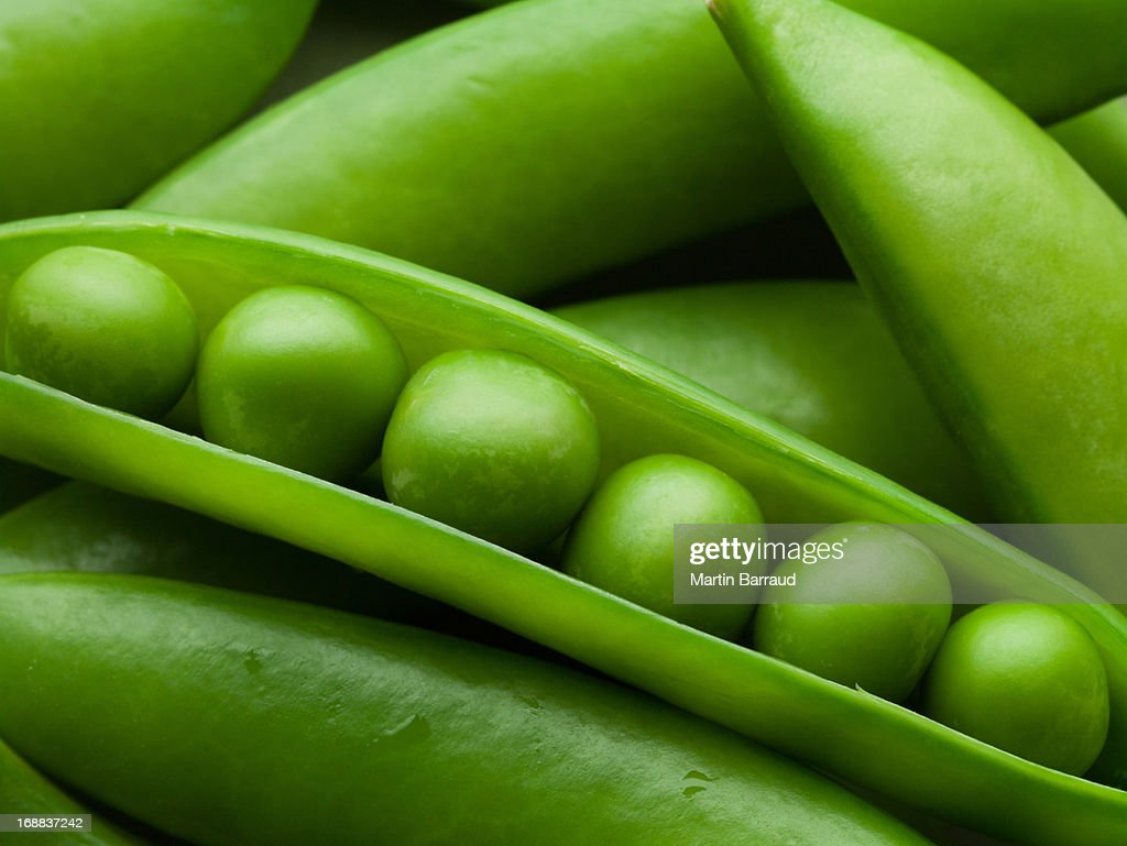 Close up of peas in pea pod : Stock Photo