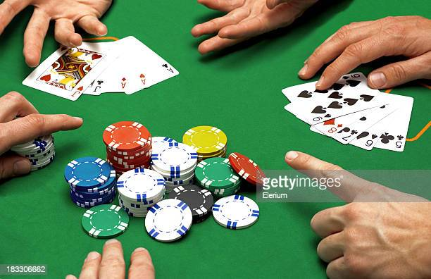 Close up of people playing poker
