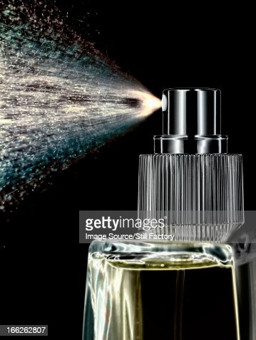 Close up of perfume spraying from bottle