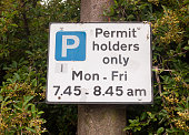 close up of permit holders only parking sign; UK