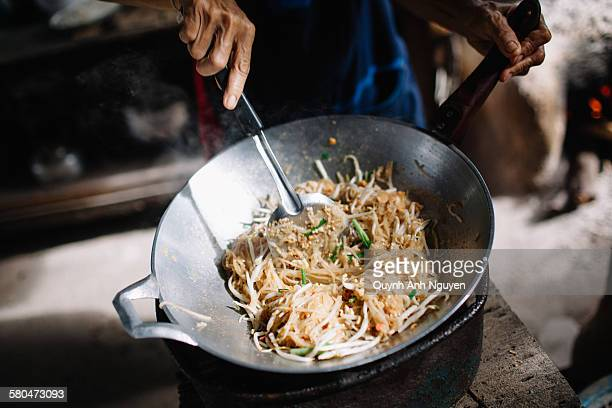Close up of person making pad thai