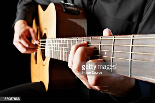 Close up of person playing classical guitar